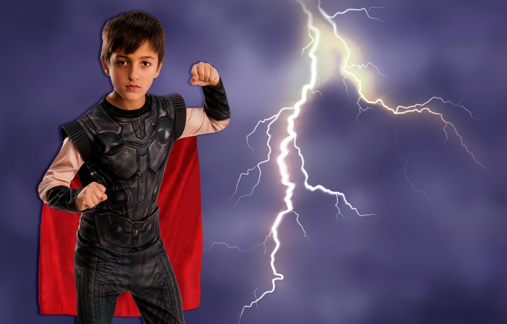 Boy dressed in Thor costume from Avengers Endgame.