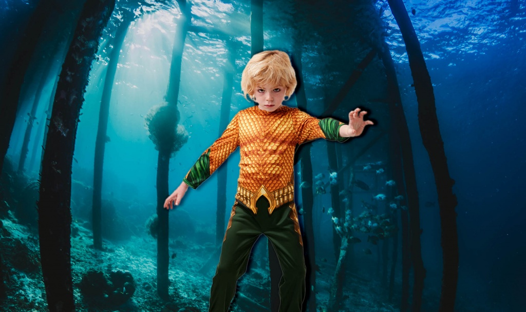 Boy wearing a gold and green Aquaman costume in underwater scene.