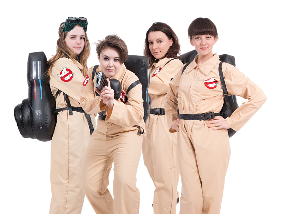 Four women dressed in Ghostbusters boiler suits.