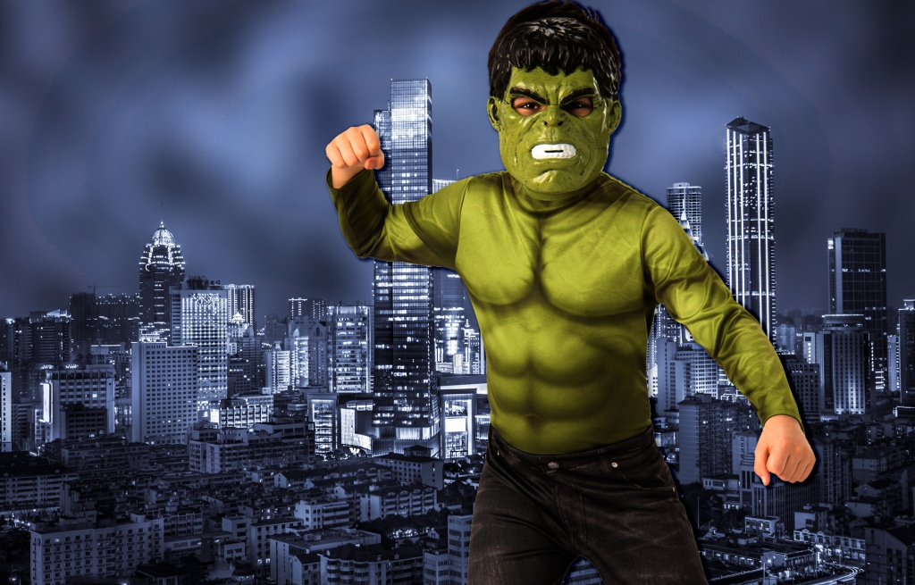 Boy wearing green Incredible Hulk costume with mask.