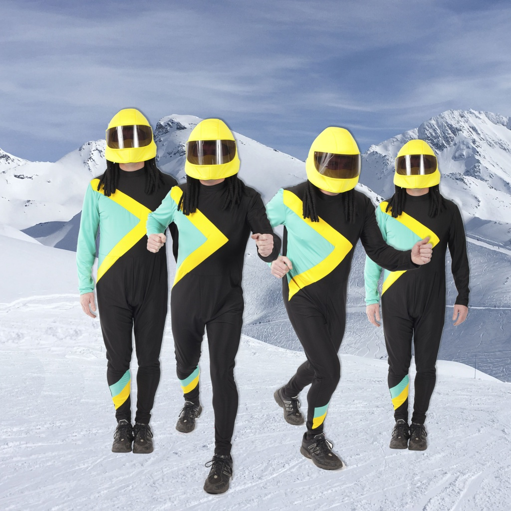 Men wearing Cool Runnings skin suits  with yellow helmets with attached dreadlocks.