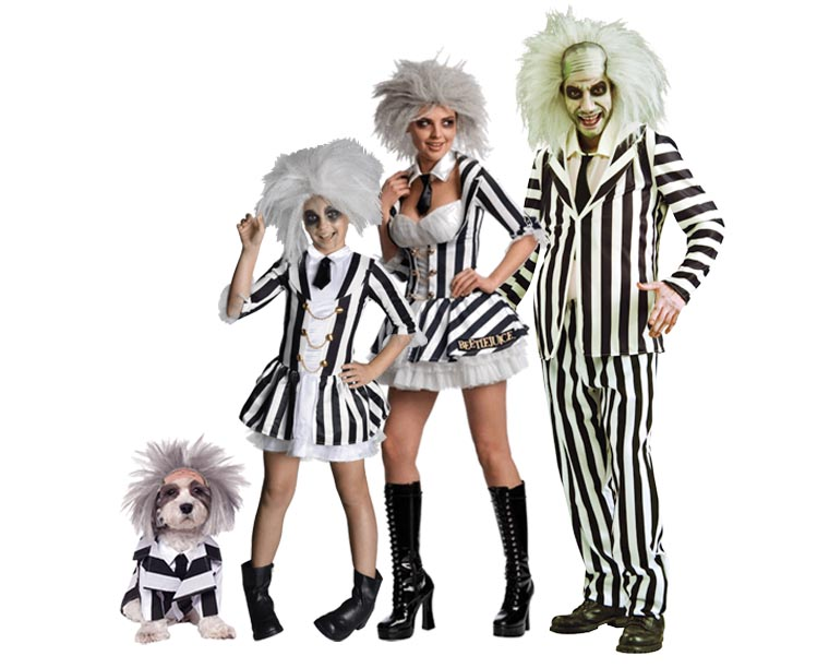 A family and their dog wearing Beetlejuice Halloween costumes.