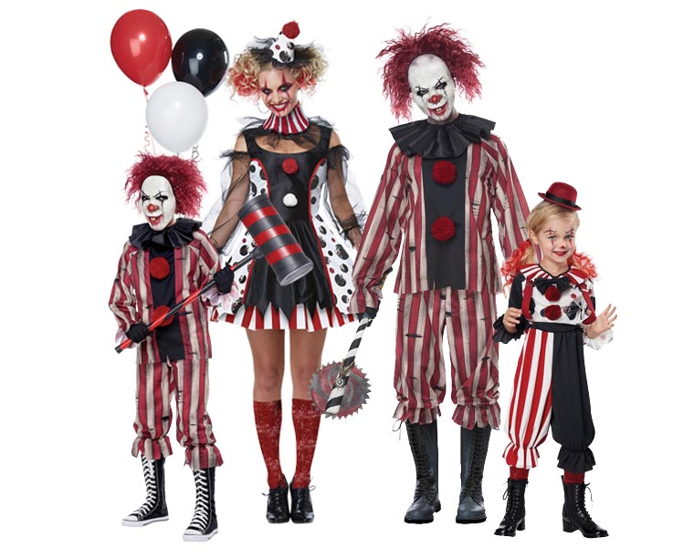 A family wearing matching clown costumes for sinister circus fancy dress.