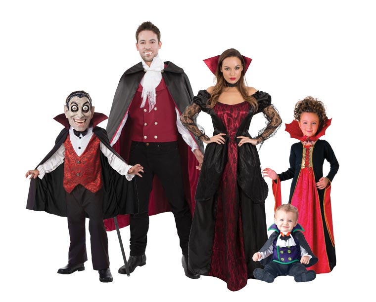 A family wearing red and black vampire costumes for Halloween.