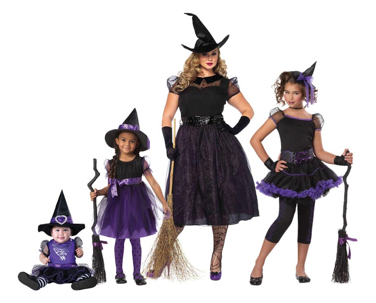 A family wearing black and purple witch costumes for Halloween.