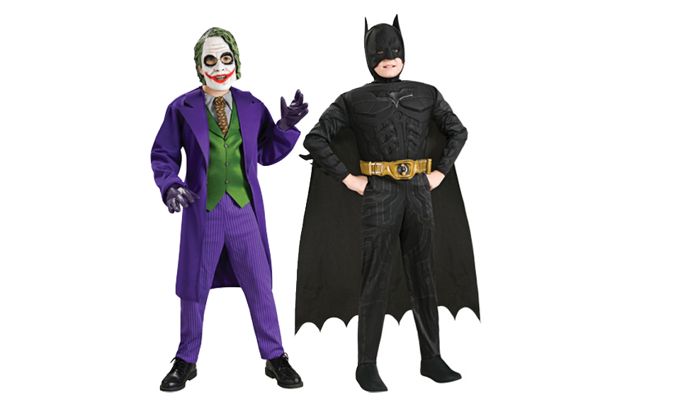 Two children wearing  Batman and Joker costumes.