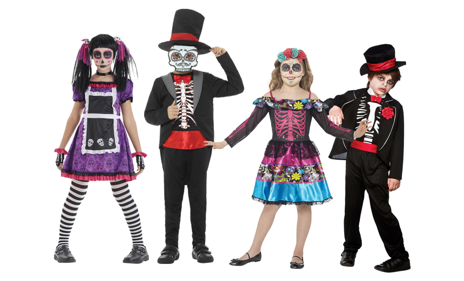 Four children wearing floral and skeleton Day of the Dead costumes.