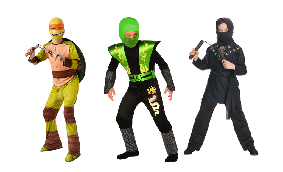 Three boys wearing ninja costumes including one wearing a Teenage Mutant Ninja Turtles costume.