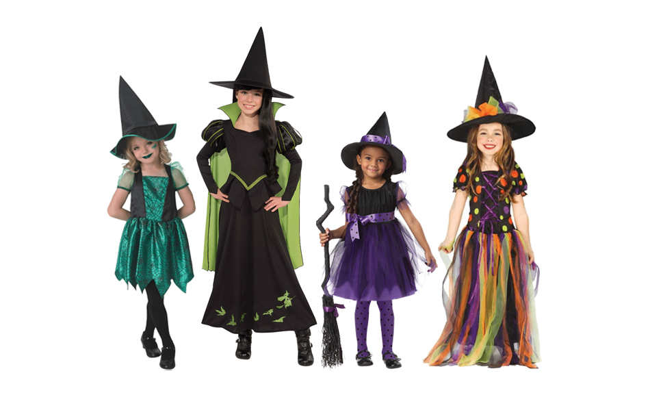 A group of girls wearing different coloured witch costumes with pointed hats.