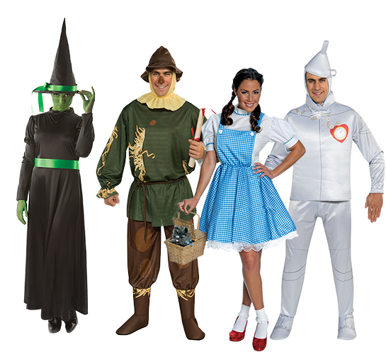 A group of adults wearing Wizard of Oz costumes including the Wicked Witch of the West, the Scarecrow, the Tin-Man and Dorothy.